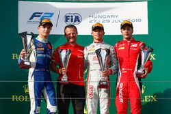 Nyck De Vries, PREMA Racing celebrates on the podium after winning the race with Lando Norris, Carlin, and Antonio Fuoco, Charouz Racing System