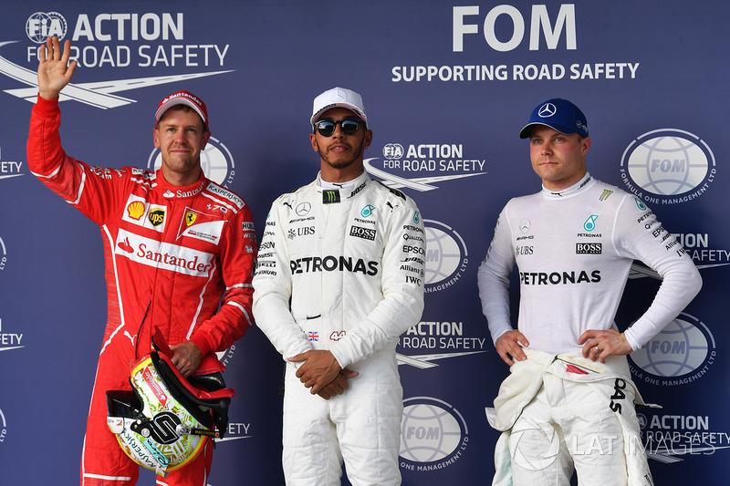 Polesitter Lewis Hamilton, Mercedes AMG F1, second place Sebastian Vettel, Ferrari, third place Valt