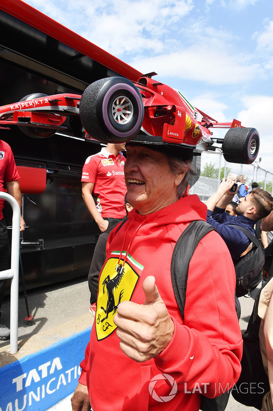 Ferrari fan with Ferrari car hat