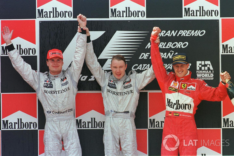 Podium: winner Mika Hakkinen, McLaren, second place David Coulthard, McLaren, third place Michael Schumacher, Ferrari