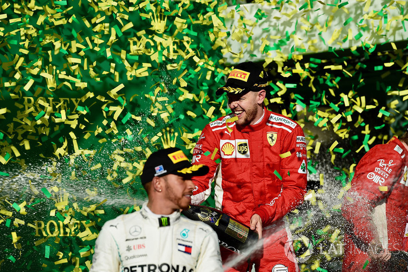 Lewis Hamilton, Mercedes-AMG F1 and Sebastian Vettel, Ferrari celebrate on the podium with the champ