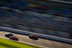 #31 Bodymotion Racing, Porsche Cayman: Drake Kemper, Devin Jones; #18 RS1, Porsche Cayman: Aurora St