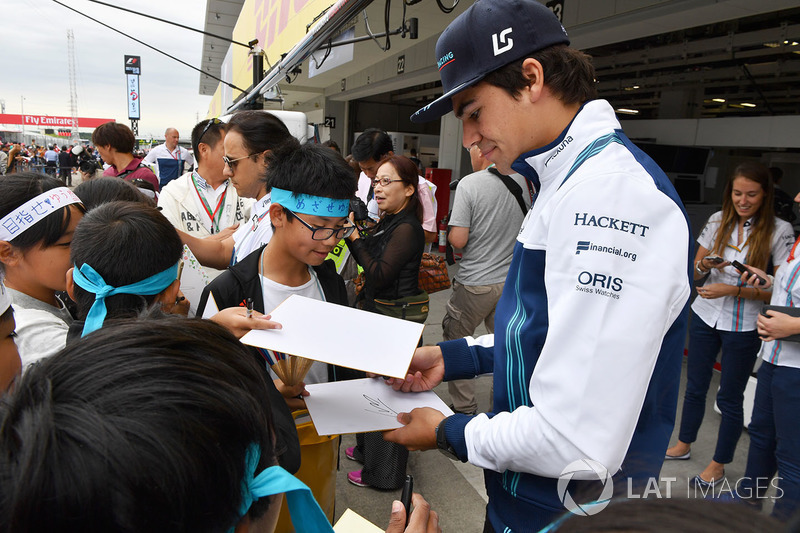 Lance Stroll, Williams, signs autographs for the fans