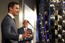 2016 Indy 500 winner Alexander Rossi with the Borg-Warner Trophy and James Verrier of BorgWarner