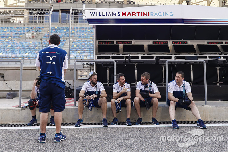Williams team members in the pit lane