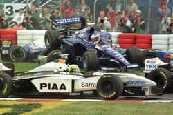 Jarno Trulli, Prost flies through the air before landing on top of Alexander Wurz, Benetton and Rica
