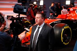 Zak Brown, Executive Director of McLaren Technology Group, is interviewed by the media