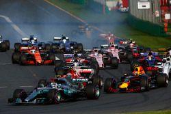 Valtteri Bottas, Mercedes AMG F1 W08, leads Max Verstappen, Red Bull Racing RB13, Kimi Raikkonen, Fe