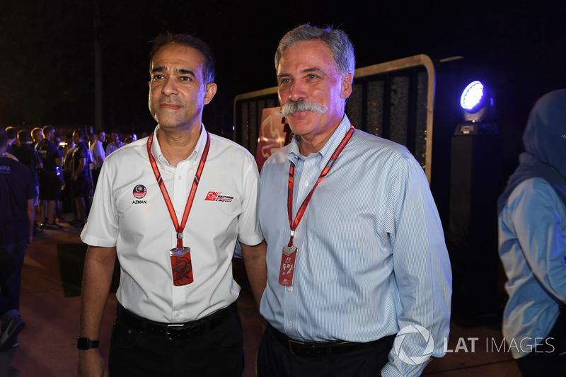 Тан Шрі Азман, голова траси Сепанг, Чейз Кері, голова групи Формули 1, на барбекю у Петронас
