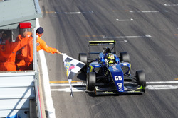 Checkered flag for Enaam Ahmed, Carlin