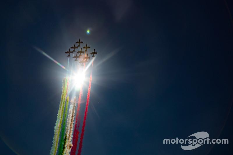 The Italian Ir Force Aerobatics team, Frecce Tricolri, overfly the grid in their Aermacchi MB-339 PA