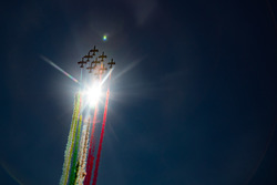 The Italian Ir Force Aerobatics team, Frecce Tricolri, overfly the grid in their Aermacchi MB-339 PA
