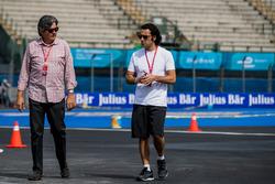 TV Commentator Dario Franchitti walks the track