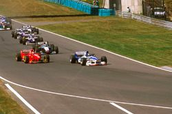Damon Hill, Arrows A18 Yamaha, Eddie Irvine, Ferrari F310B and Mika Hakkinen McLaren MP4/12 Mercedes
