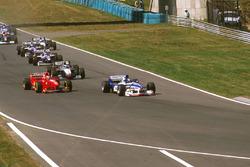 Damon Hill, Arrows A18 Yamaha, Eddie Irvine, Ferrari F310B et Mika Hakkinen, McLaren MP4/12 Mercedes