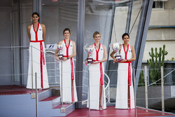 Grid girls on the podium, with the trophies