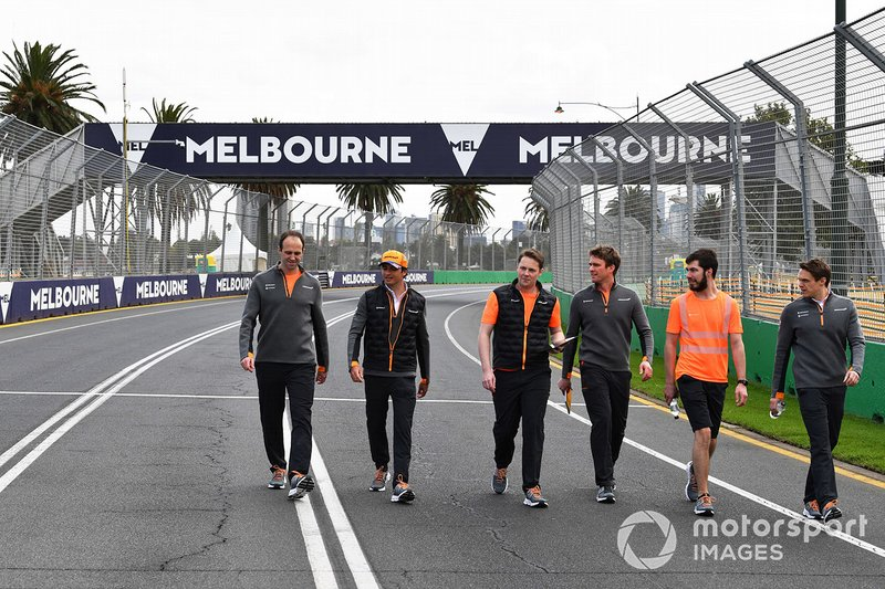 Carlos Sainz Jr., McLaren, walks the track with his team
