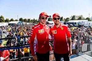 Sebastian Vettel, Ferrari and Charles Leclerc, Ferrari, arrive for the autograph session