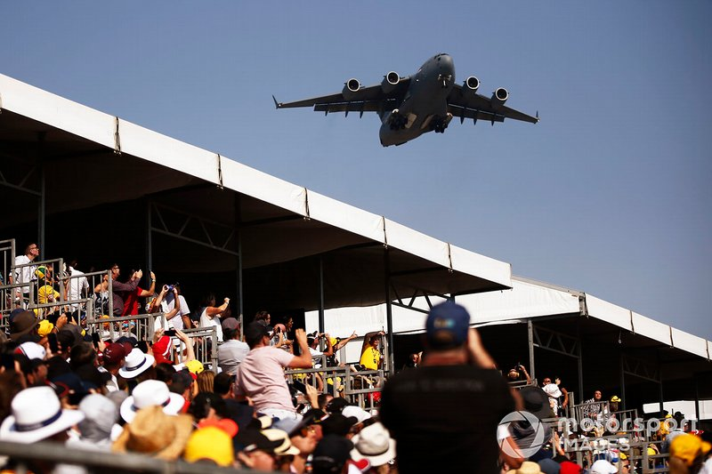 A Boeing C-17A Globemaster III of the Royal Australian Air Force flies over the grid prior to the start