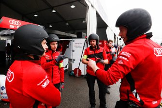 The Audi Sport ABT Schaeffler team chat in the pit lane