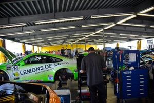 Trans-Am crews work on their cars after practice