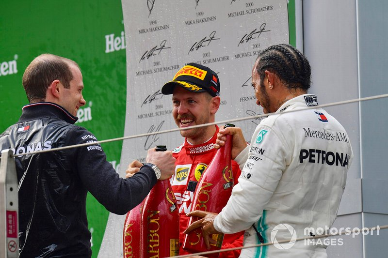 Sebastian Vettel, Ferrari, 3rd position, and Lewis Hamilton, Mercedes AMG F1, 1st position, on the podium