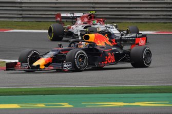 Max Verstappen, Red Bull Racing RB15, leads Antonio Giovinazzi, Alfa Romeo Racing C38