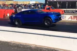 Electric Chevy Camaro pops wheel at strip