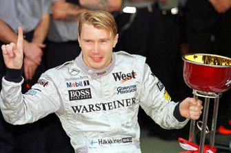 Mika Hakkinen celebrates winning the Formula One World Championship