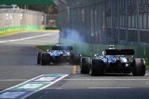 Lewis Hamilton, Mercedes AMG F1 W10, leads Valtteri Bottas, Mercedes AMG W10, onto the circuit
