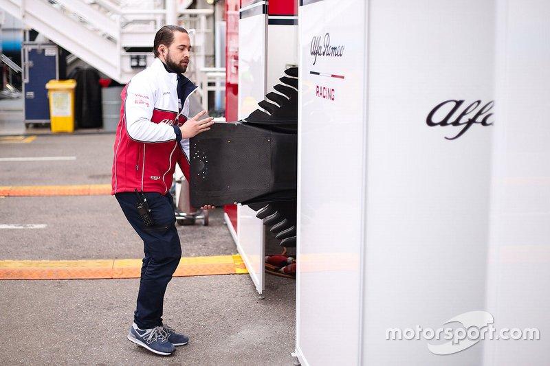 Alfa Romeo Racing team member with floor bodywork