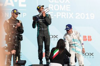 Mitch Evans, Panasonic Jaguar Racing, 1st position, kisses his trophy on the podium alongside Andre Lotterer, DS TECHEETAH, 2nd position, Stoffel Vandoorne, HWA Racelab, 3rd position,