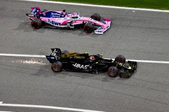 Sergio Perez, Racing Point RP19 and Kevin Magnussen, Haas F1 Team VF-19