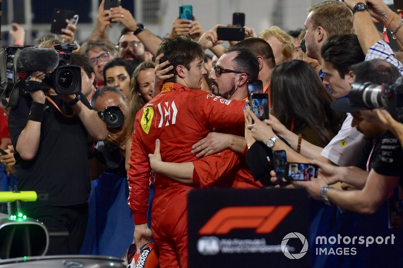 Charles Leclerc, Ferrari, with his team