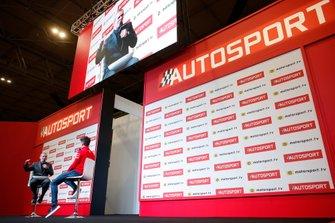 Il presentatore Stuart Codling intervista Charles Leclerc, Ferrari, sul palco dell'Autosport