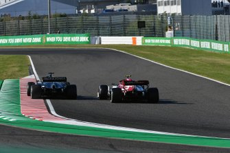 Romain Grosjean, Haas F1 Team VF-19, leads Antonio Giovinazzi, Alfa Romeo Racing C38