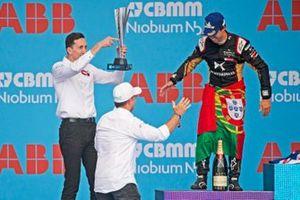 James Barclay, Team Director, Panasonic Jaguar Racing celebrates with the constructor's trophy as Rubens Barrichello greets Antonio Felix da Costa, DS Techeetah, 2nd position, on the podium