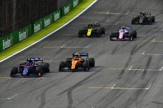 Daniil Kvyat, Toro Rosso STR14, leads Lando Norris, McLaren MCL34, Lance Stroll, Racing Point RP19, Nico Hulkenberg, Renault F1 Team R.S. 19, and Kevin Magnussen, Haas F1 Team VF-19