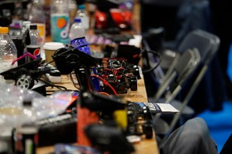 Remote-controlled cars being prepared