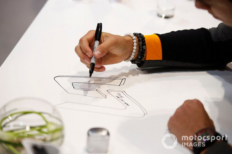 Lando Norris, McLaren leaves his mark on a table at the Autosport show