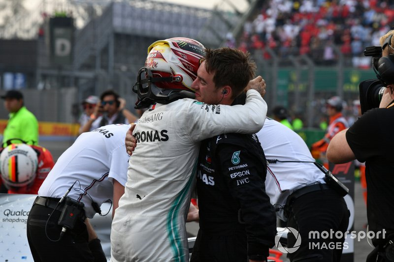 Lewis Hamilton, Mercedes AMG F1, 1st position, celebrates with a team mate in Parc Ferme