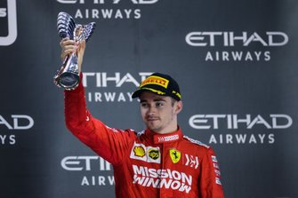 Charles Leclerc, Ferrari, 3rd position, on the podium with his trophy