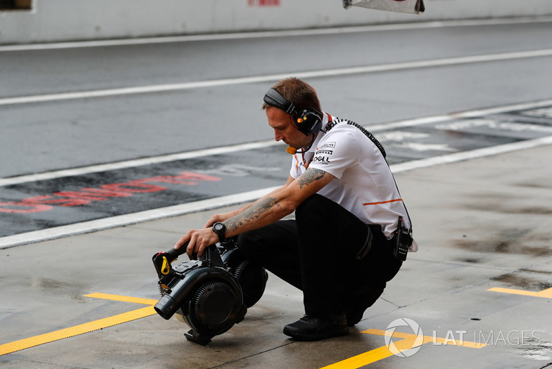 A McLaren engineer with some brake coolers
