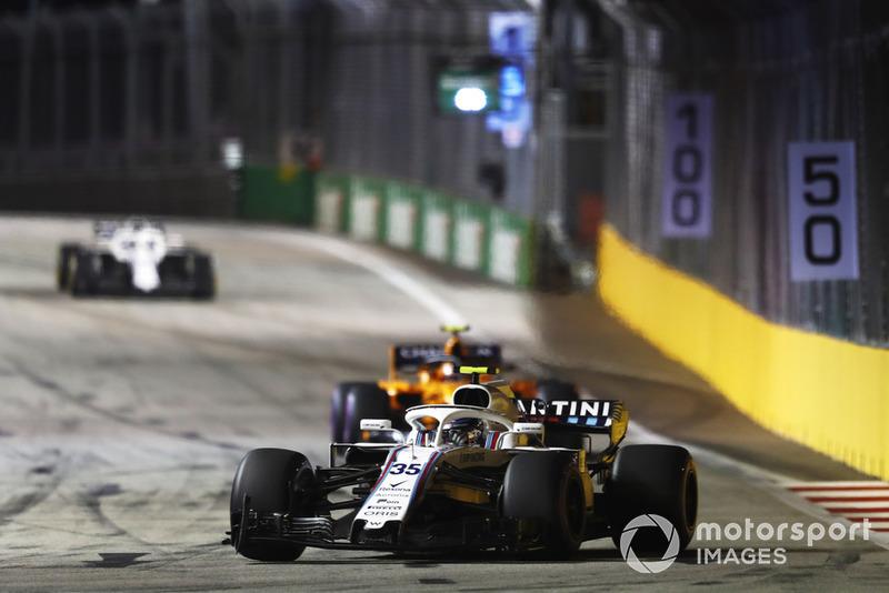Sergey Sirotkin, Williams FW41, leads Stoffel Vandoorne, McLaren MCL33