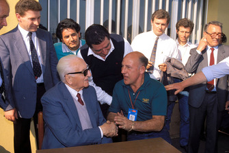 Modena 1987, Enzo Ferrari with Stirling Moss, during the Mille Miglia veterans parade at the Scaglietti factory