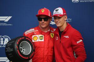 Mick Shcumacher presents the Pirelli Pole Position Award to Kimi Raikkonen, Ferrari