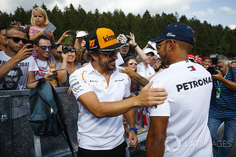 Fernando Alonso, McLaren, is greeted by Lewis Hamilton, Mercedes AMG F1