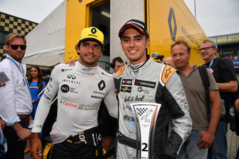 Carlos Sainz Jr., Renault F1 Team with Mikel Azcona, PCR Sport Cupra TCR