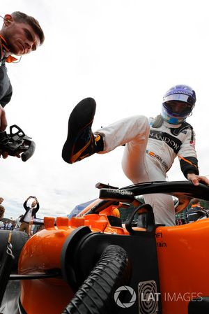 Fernando Alonso, McLaren, exits his car on the grid