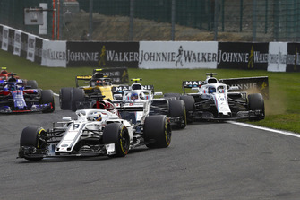 Marcus Ericsson, Sauber C37, leads Sergey Sirotkin, Williams FW41, Lance Stroll, Williams FW41, and Carlos Sainz Jr., Renault Sport F1 Team R.S. 18